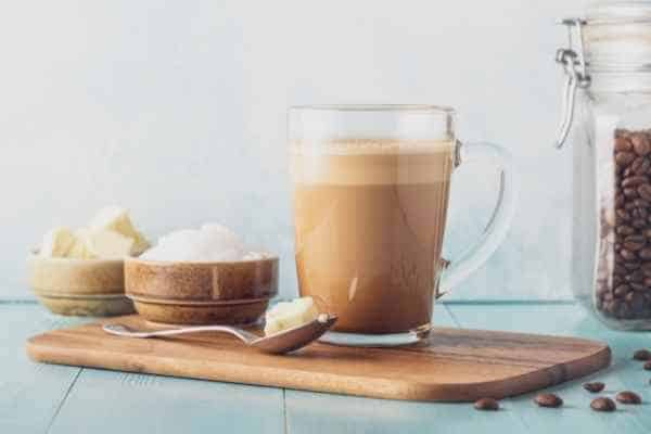 bulletproof coffee in a cup on a plate