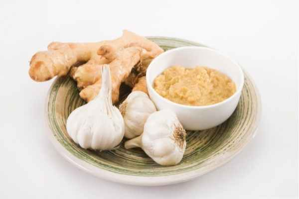 ginger and garlic blended into a paste in a plate