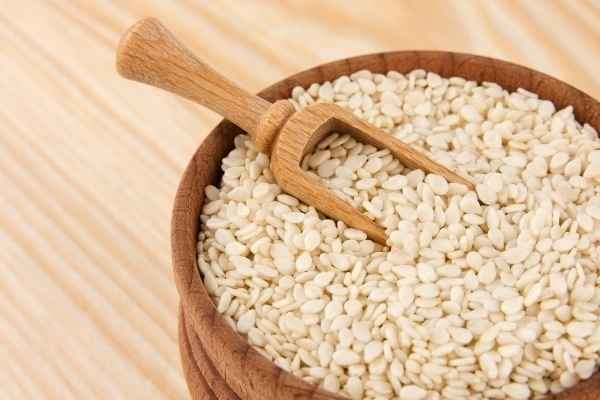 sesame seeds in a bowl with a spoon